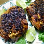 Grilled Lime Adobo Rubbed Pork Chops have the flavor of Mexico with lime on green leaf platter