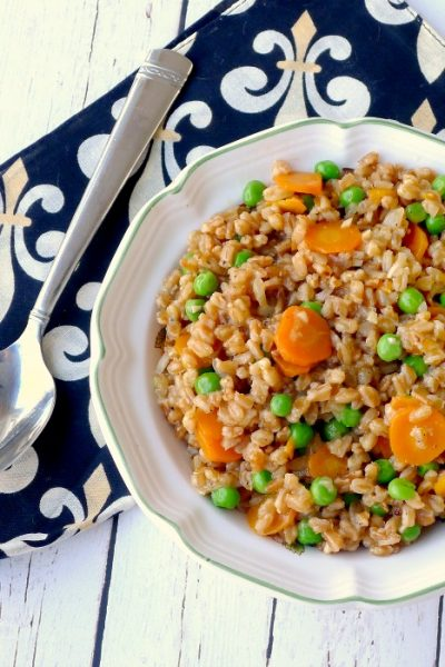 Farro and Peas - Risi e Bisi is a take on a Venetian classic that swaps the rice for the rice giving the dish a nutty flavor with a chewy texture.