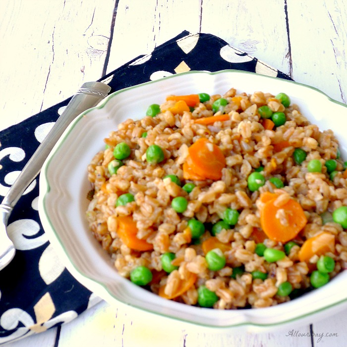 Farro and Peas - Risi e Bisi is a take on a Venetian classic that swaps farro for the rice giving the dish a nutty flavor with a chewy texture.