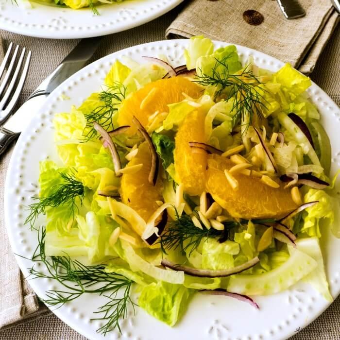 Fennel Orange Salad is a light salad with shaved fennel, sweet orange segments, slivered purple onion, and crunchy romaine and. A light citrus vinaigrette dresses the salad. @allourway.com
