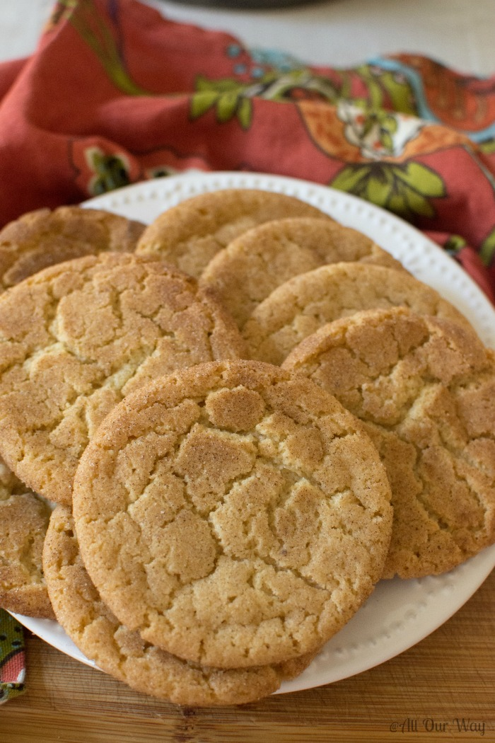 Brown Butter Snickerdoodle Cookie Recipe strays from the traditional recipe to brown the butter first. The cookies taste rich and nutty with a crispy texture and a cinnamon topping. One bite and these cookies will have you sighing in content. They travel well and are perfect for picnics or lunch boxes. They also freeze well. #cookies, #snickerdoodlerecipe, #brownbuttercookies, #brownbuttersnickerdoodles, #lunchboxcookies, #picniccookies, #allourway
