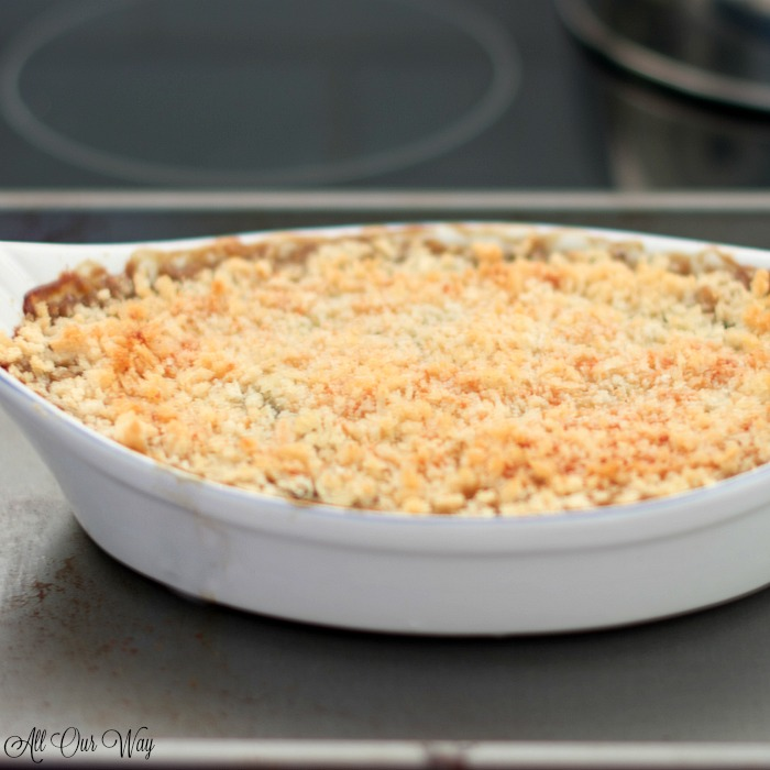 Spinach gratin with brown bread crumbs in oven.