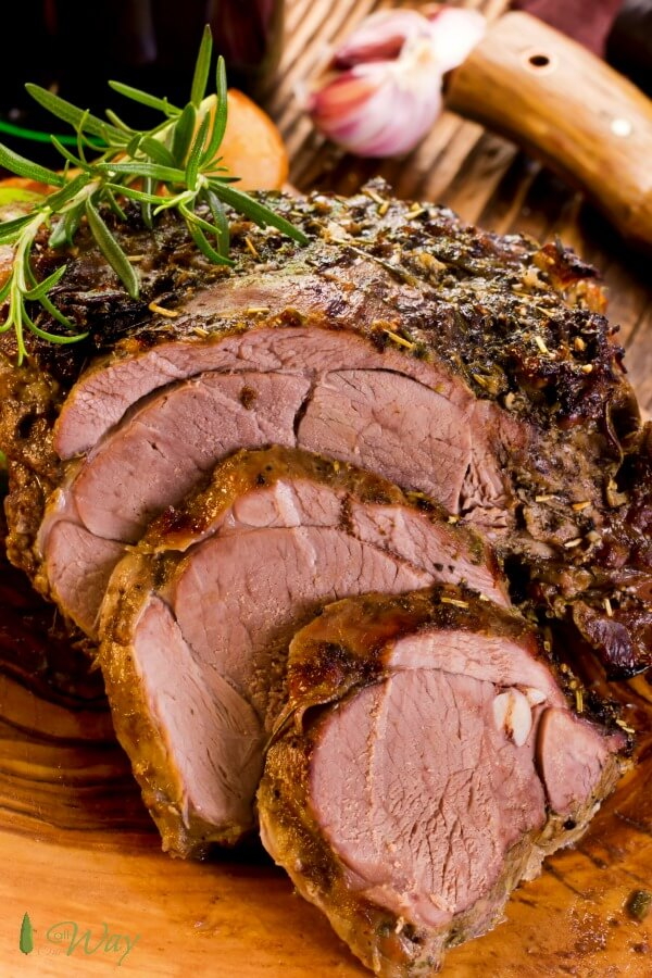 Roast Boneless Leg of Lamb is perfect for Easter Dinner or any special meal. The meat is tender and flavorful with the taste of fresh herbs and garlic. #lamb, #legoflamb, #roastlamb #bonelesslegoflamb, #Easterlamb, #roastlambrecipe, #stuffedlambroast #allourway