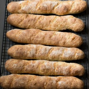 Crusty French Baguettes 4 hour recipe can be made in long loaves or rolls. Easy recipe with no starter necessary.