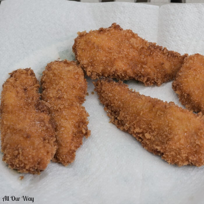Crispy Fried Chicken cooks to a golden brown while the inside meat is moist and tender with a spicy tang.