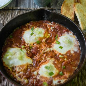 Spicy Eggs in Purgatory poaches eggs in a spicy tomato sauce. Quick and easy.