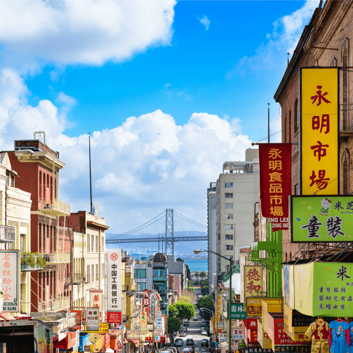 Photo of Chinatown in San Francisco with the San Francisco bridge in the background. Chop Suey originated in San Francisco in the late 1900s.