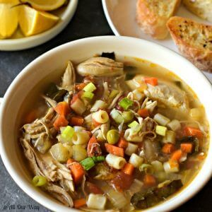 Close up of roasted chicken vegetable soup with pasta in bowl