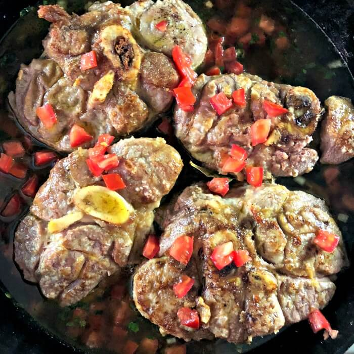 Veal Shanks in cast iron pan with vegetables