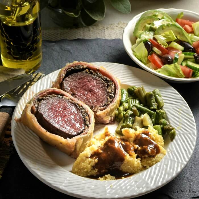 Italian Venison Wellington on plate with polenta and Marsala sauce. #venison_tenderloin, #venison_fillet, #deer_tenderloin, #puff_pastry, #Wellington, #allourway