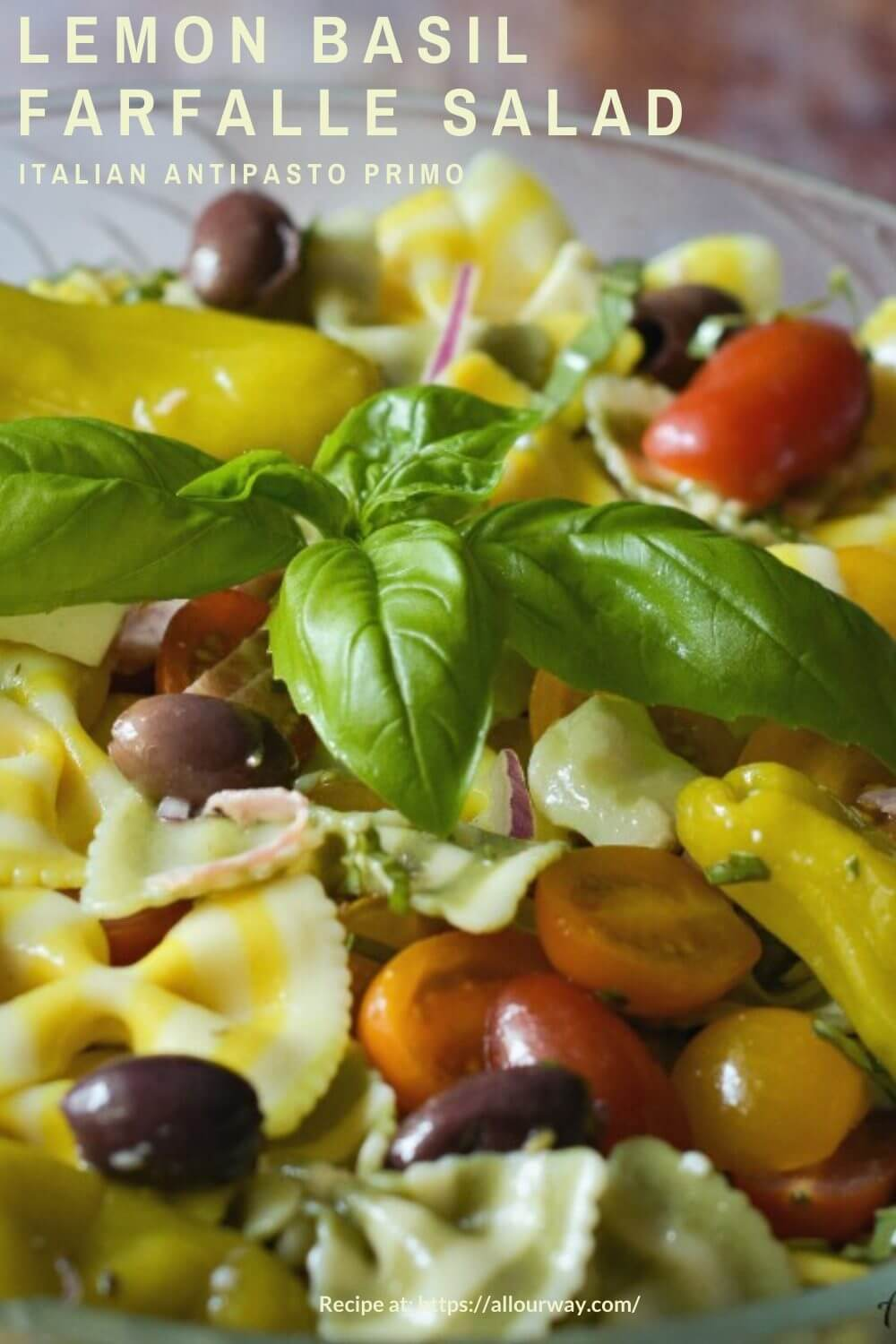 Lemon and Basil Farfalle Salad combines striped bow ties with grape tomatoes, genoa salami, fresh mozzarella, peperoncini, and a light vinaigrette. It is an ideal dish for gatherings because it can be made ahead a stores well. #pastasalad, #antipasto