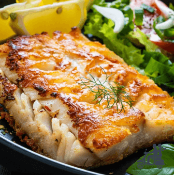 Grilled Halibut with lemon on a bed of greens.