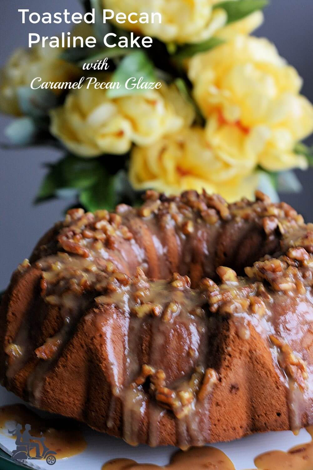 This is a butter rich pound cake that's soft and moist and studded with toasted pecans and heath bits. To finish it off we pour a caramel pecan glaze over it adding to the fantastic flavor. A cake that's an easy dessert to make but beautiful and flavorful so that it makes an occasion special.