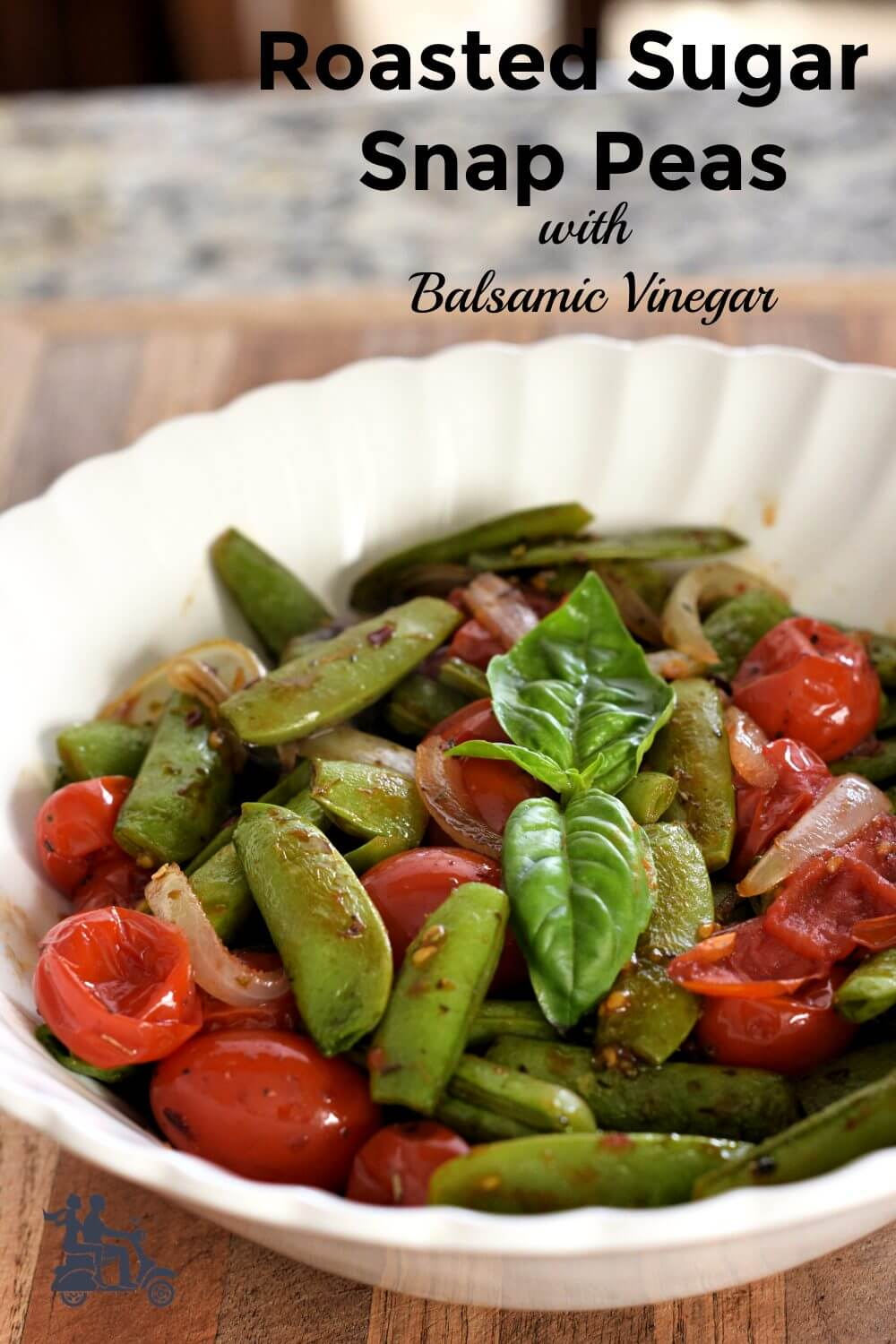 Sweet sugar snap peas, onions and grape tomatoes roast with spicy red pepper flakes and Italian seasoning. The quick vegetable side finishes with a touch of balsamic vinegar to balance the sweetness with a touch of tang. A company worthy vegetable that is easy to throw together.