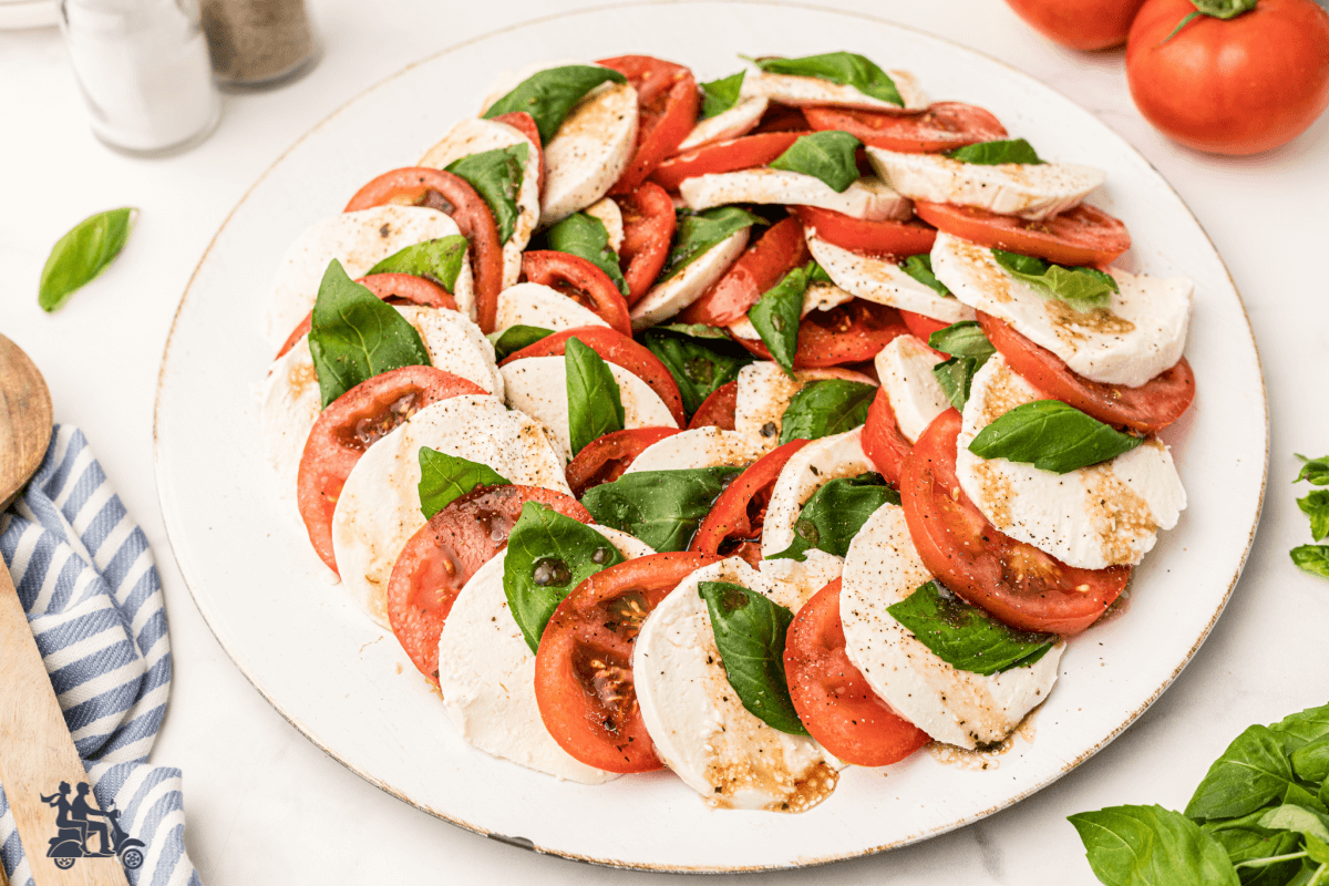 Insalata Caprese Close up. A dish that features the color of the Italian flag - red, white, green.
