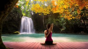 Yoga Girl Picture with Autumn Waterfall Background
