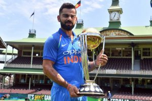 Virat Kohli cricket photo with the ICC Cricket World Cup trophy