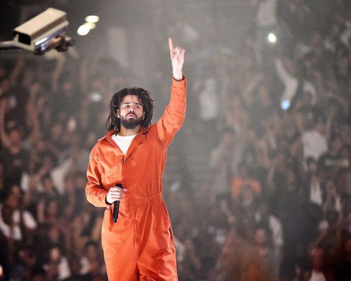 J. Cole image on stage