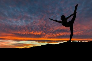 Silhouette of Woman Dancing Outdoors at Sunset