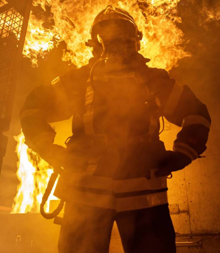 fireman standing near fire on building