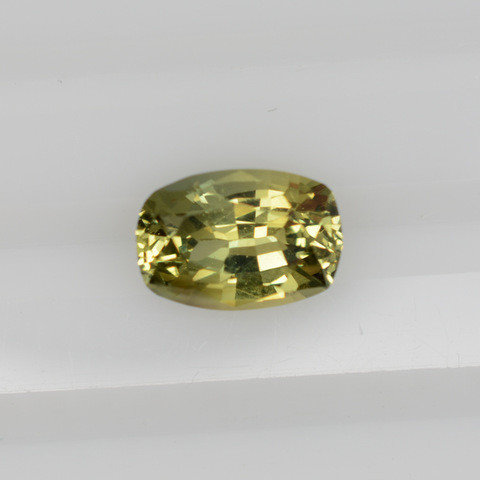 Yellow greenish cushion sapphire