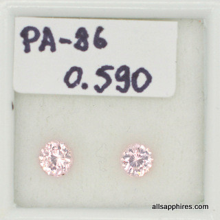 A pair of peach sapphires