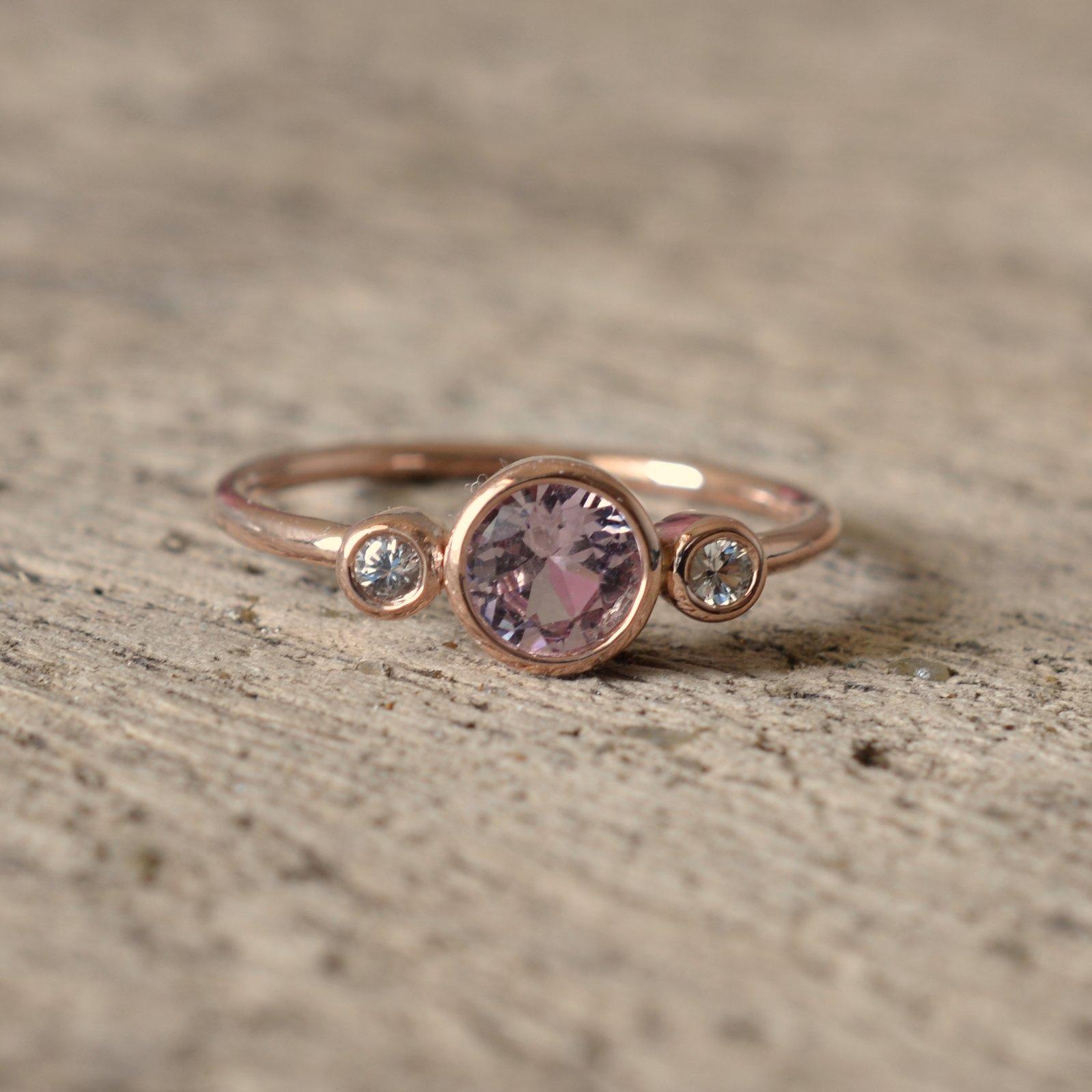 3 stones rose gold bezel ring