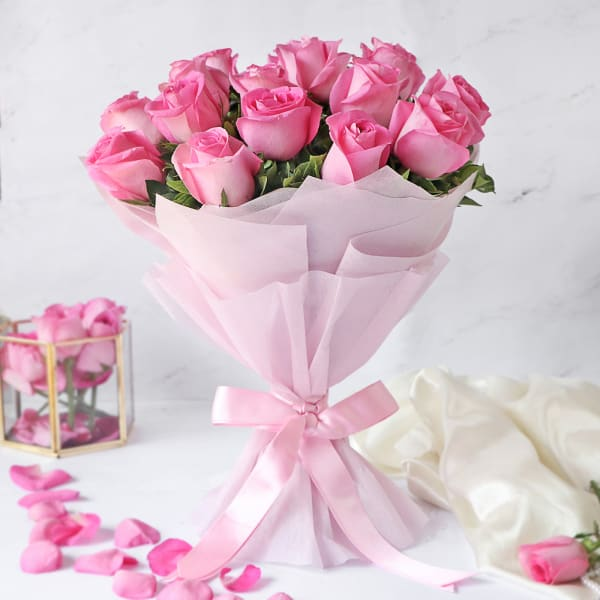 15 pink roses in matching pink wrapping paper hand bouquet