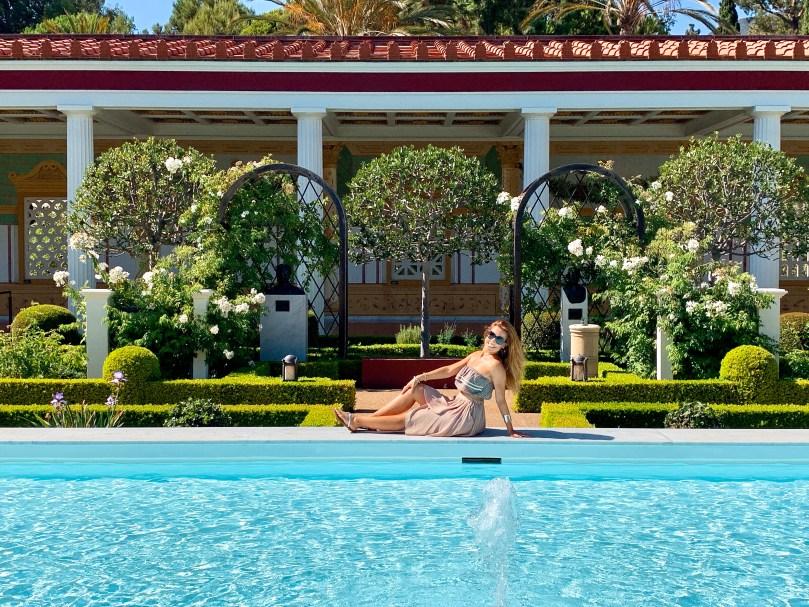 sitting on edge of pool at Getty Villa