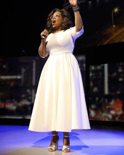 Oprah Winfrey's height is 1.69 m tall