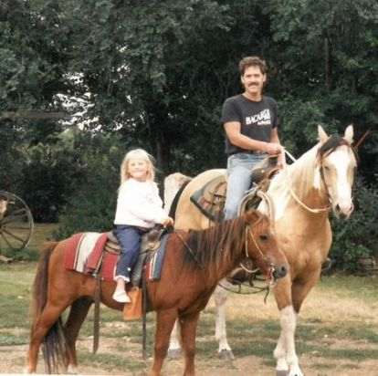 Tomi Lahren riding horse with her father