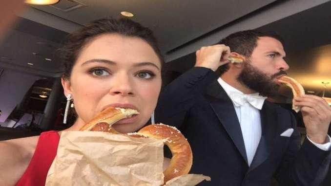 Tatiana Maslany And Tom Cullen eating sweat bread