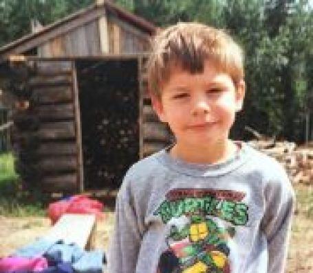 Childhood photo of Travis Milne.