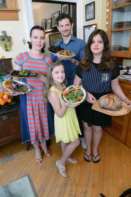 Gabriele Corcos and Debi Mazar with their children.