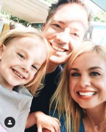 Jessica Collins with her husband, Michael Cooney and her daughter, Jemma Kate.