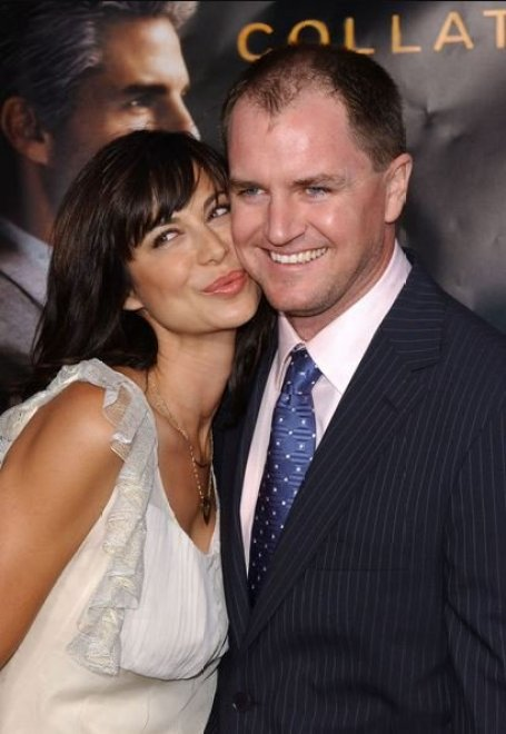 Adam Beason and his wife, Catherine Bell arrived at the Premiere of Collateral at The Orpheum Theatre, Los Angeles, California on 2nd August 2004.