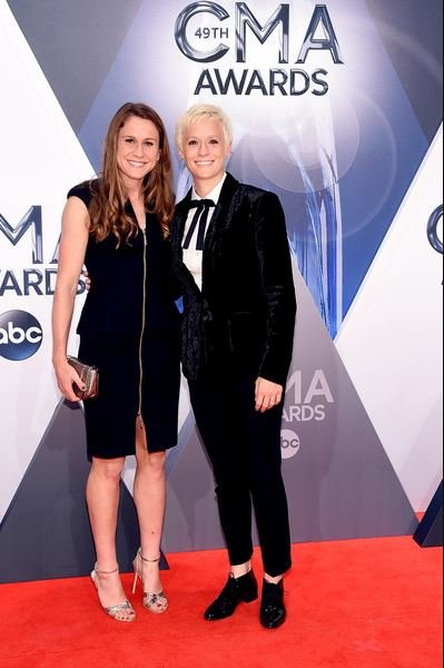 Megan Rapinoe and her ex-partner, Sera Cahoone attend the 49th annual CMA Awards at the Bridgestone Arena on 4th November 2015, in Nashville, Tennessee.