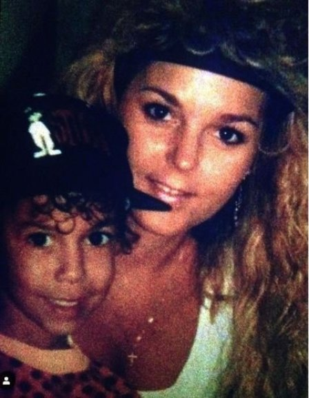 Childhood photo of Bryton James with his mother.