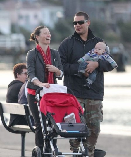 Evangeline Lilly and her love partner, Norman Kali walking with their kids.