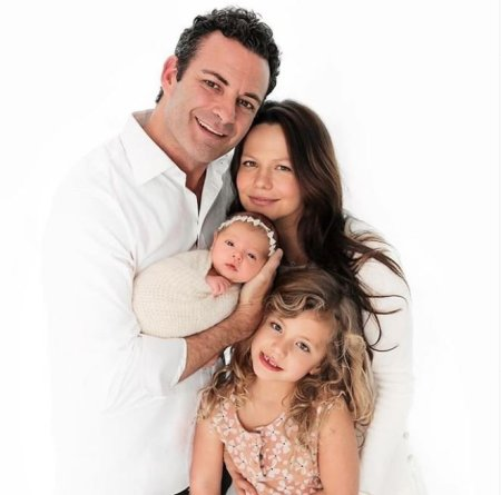 Photo of Tammin Sursok with her husband and their children.