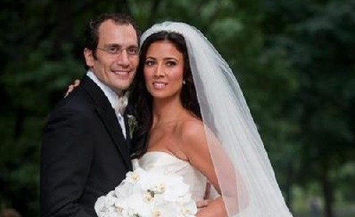 Andrew Sansone with his wife in their wedding