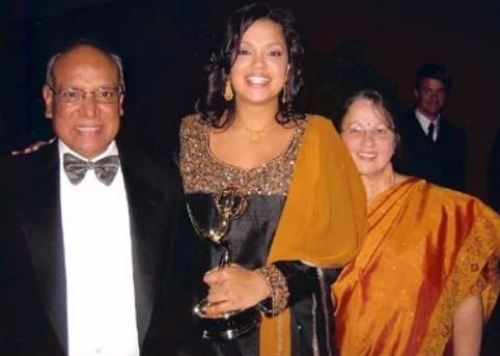 Sukanya Krishnan with her parents after winning an Emmy in 2006