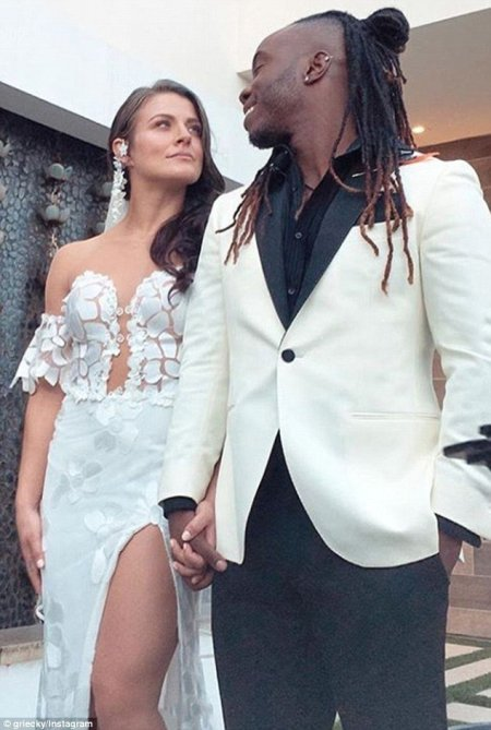 Janelle Ginestra with her husband at their wedding