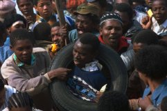 """Death By Tire Fire: A History Of """"Necklacing"""" In Apartheid South Africa"""