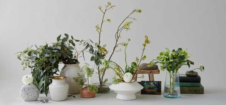 Bloomist is such a great resource on this Most Loved Sites for Interiors list. Pictured: Collection of white, stone and glass vases holding foliage arrangements