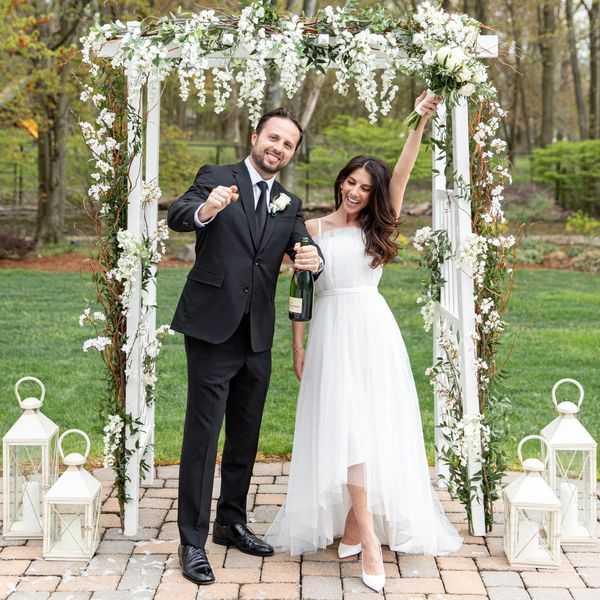 Brides is one of my Most Loved Sites for Weddings. Pictured: Bride and Groom smiling under an outdoor chuppah