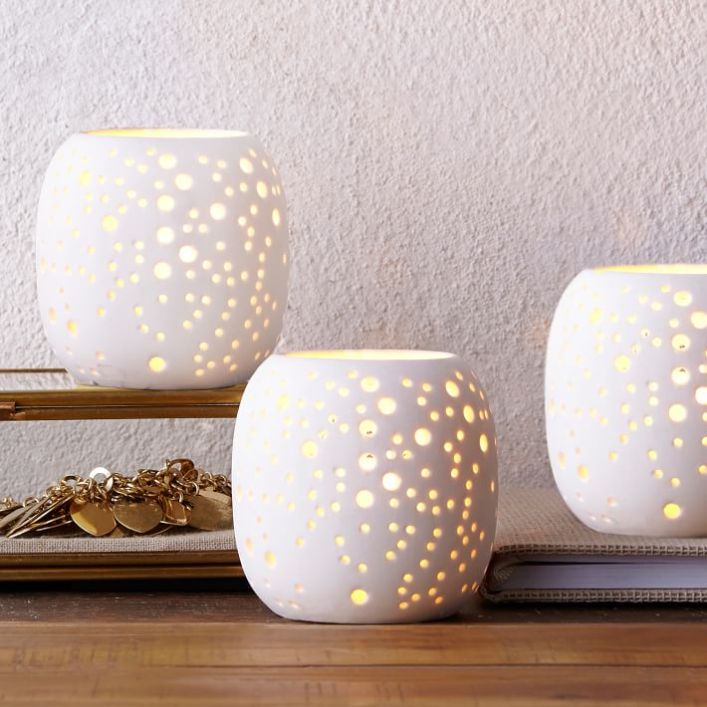 Tealight candle with small holes in it for the light to shine through, apartment decoration