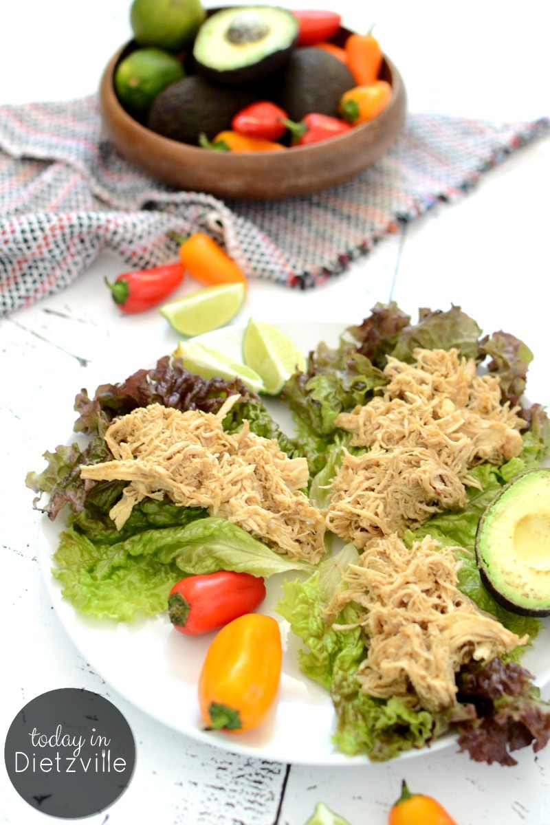 shredded Instant Pot Salsa Verde Chicken in lettuce with colorful peppers and avocado