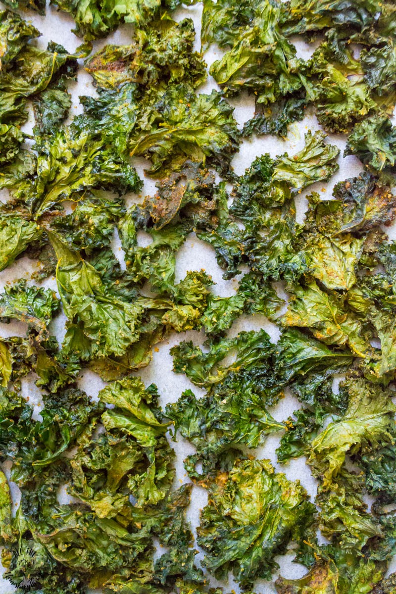 keto and whole30 chipotle kale chips on parchment paper