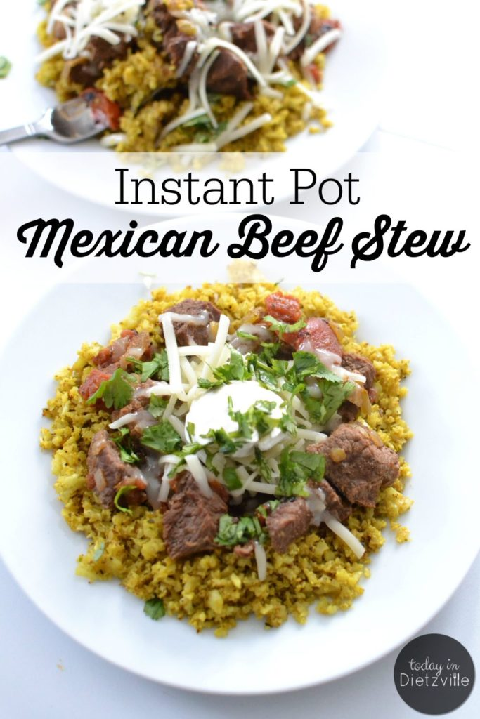 white plate Instant Pot Mexican Beef Stew with yellow rice, stew meat, sour cream, and chese